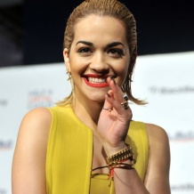 Rita Ora wears Monica Vinader Fiji Friendship Bracelets in Coral and Black to the Capital Jingle Bell Ball, London 2012.